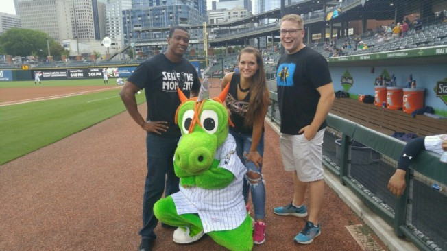 Caprice Coleman of Ring of Honor, Kelly Klein of Women of Honor, and Ian Riccaboni, ROH Broadcaster, pose with Homer the Dragon before throwing out the first pitch at the Charlotte Knights game!