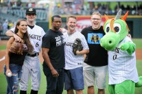 Caprice Coleman of Ring of Honor, Kelly Klein of Women of Honor, and Ian Riccaboni, ROH Broadcaster, with Knights pitcher Connor Walsh and Homer the Dragon after their first pitches
