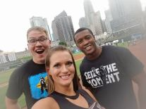 Caprice Coleman of Ring of Honor, Kelly Klein of Women of Honor, and Ian Riccaboni, ROH Broadcaster, stand outside the dugout before throwing out the first pitch at the Charlotte Knights game!